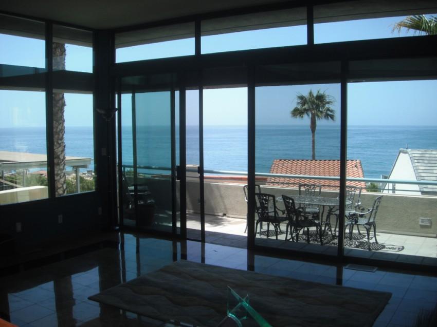 Hliníkové okenní systémy a prosklené fasády